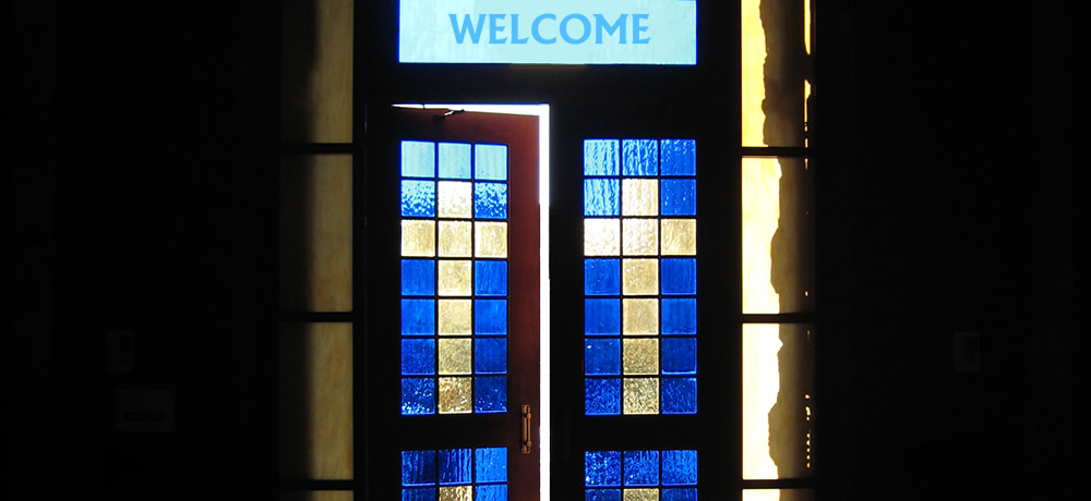 Church doors and welcome sign