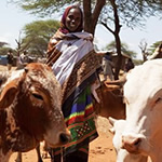 Adi was chosen by her community to receive a cow and two goats