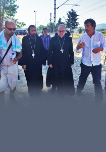 Bishop Angaelos and Bishop David Hamid with support workers at the Greece / Macedonia border