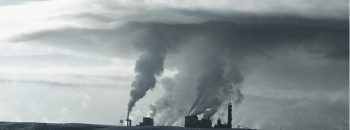 Clouds of pollution over industrial buildings