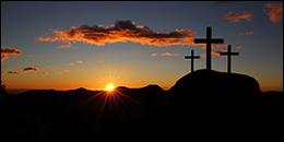 Sun rising over three crosses